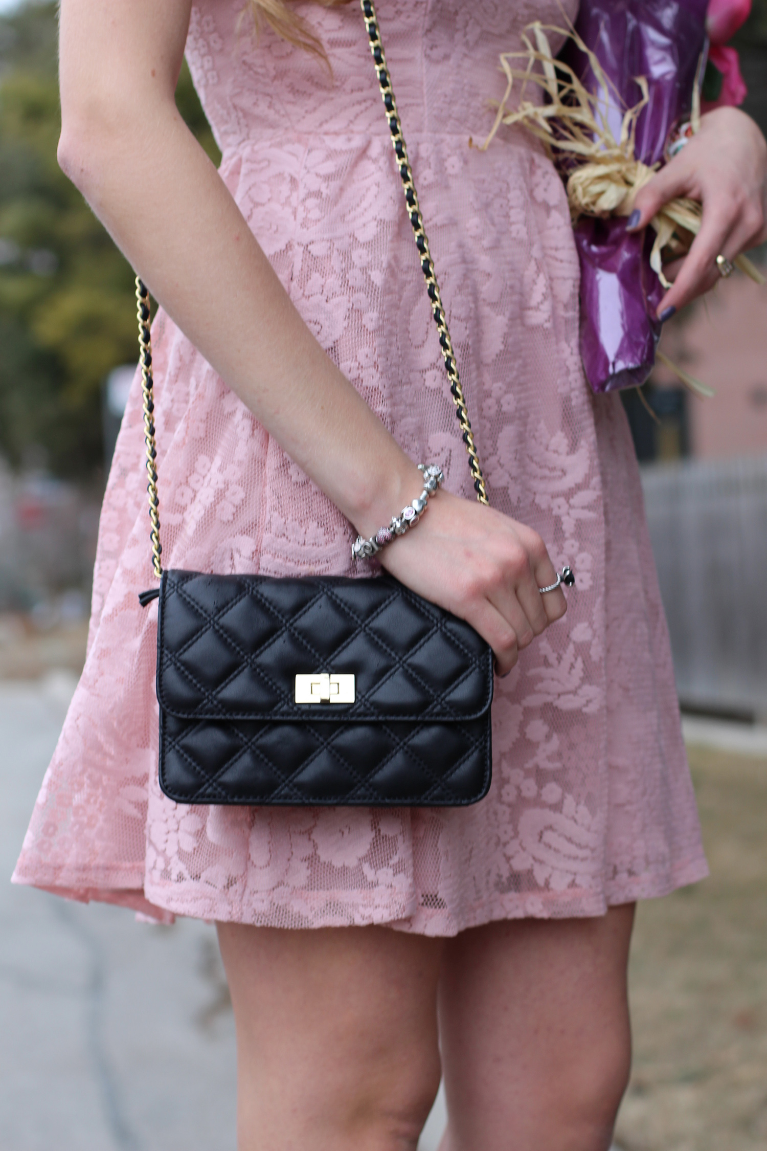 black quilted wallet on chain