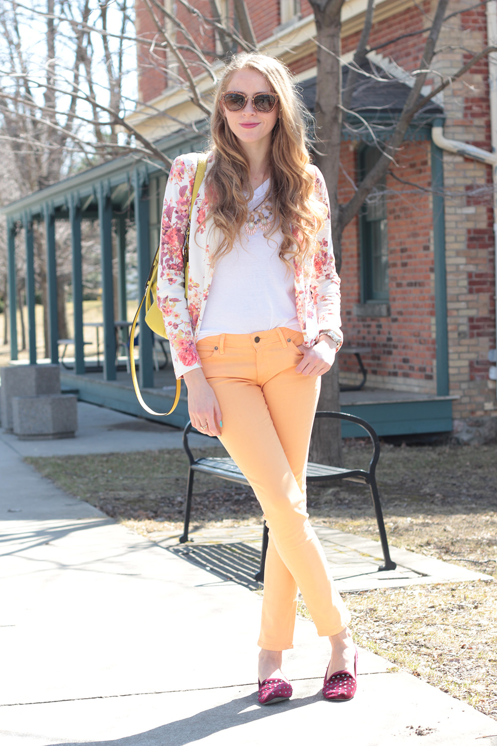 floral blazer and peach jeans