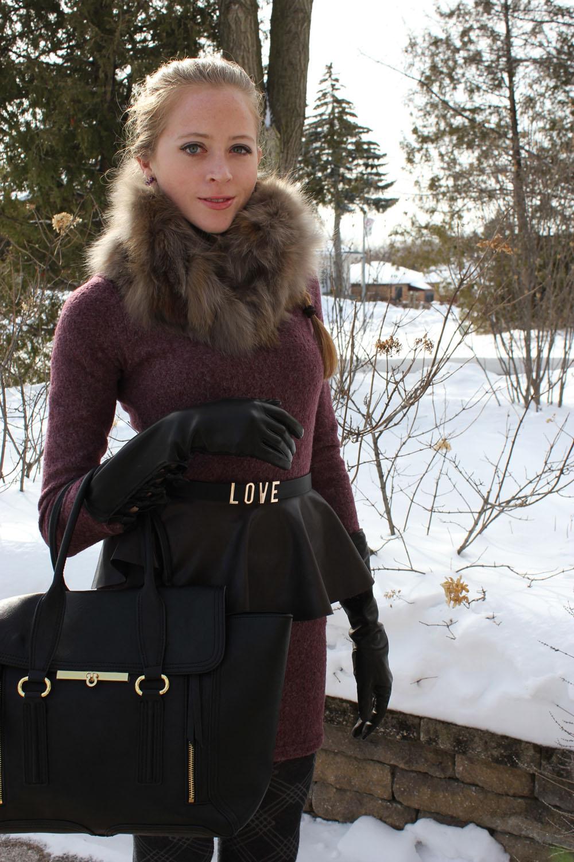 fox fur collar and black satchel