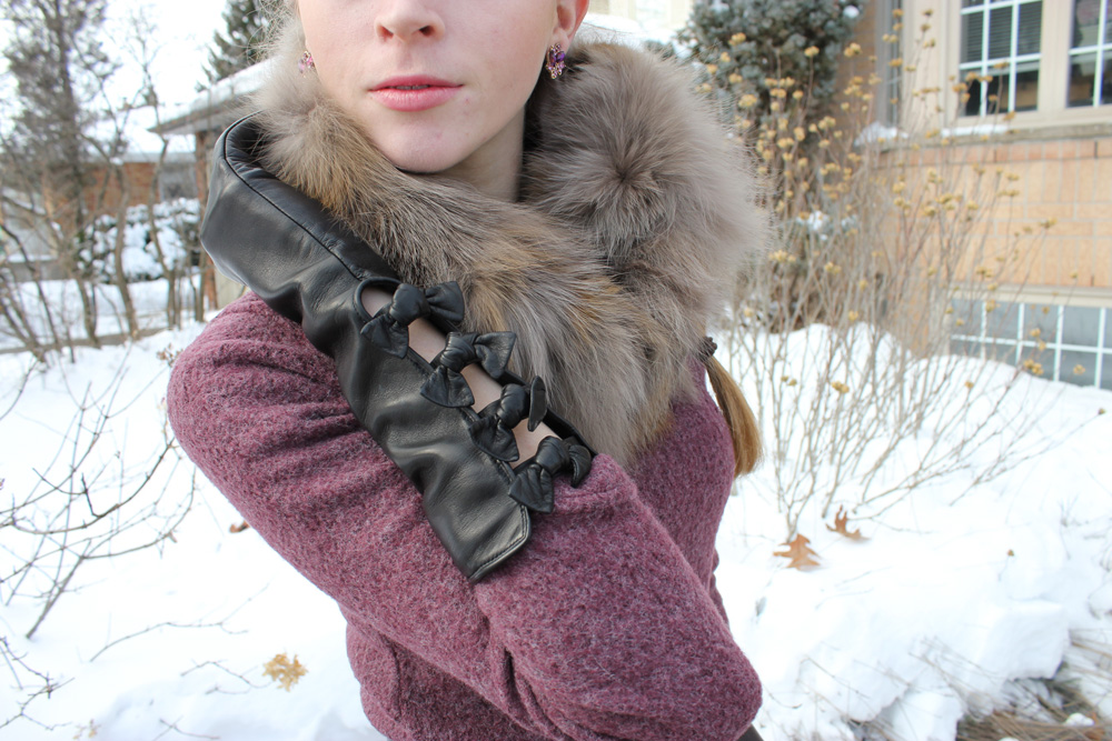 long gloves with bows and fox fur scarf
