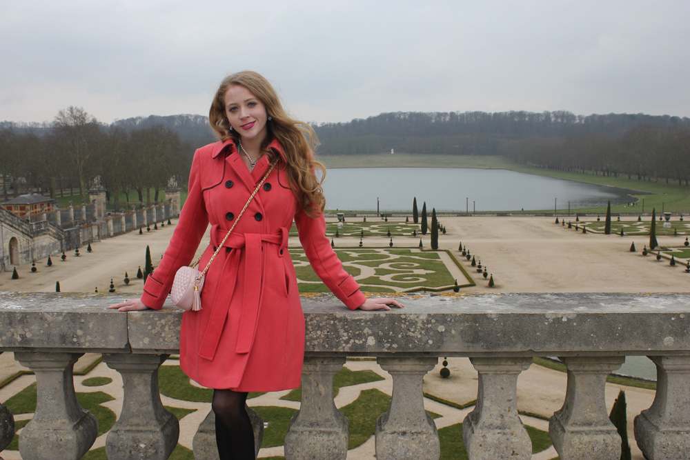 pink coat in versailles garden