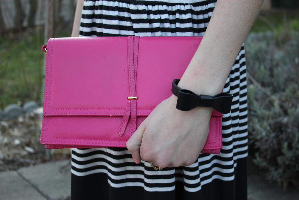 pink envelope clutch black bow bracelet