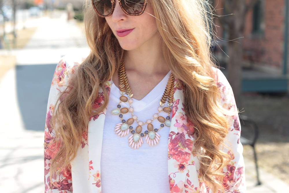 statement necklace and white tshirt and floral blazer