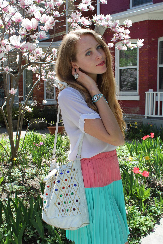 white blouse pleated skirt vintage bag